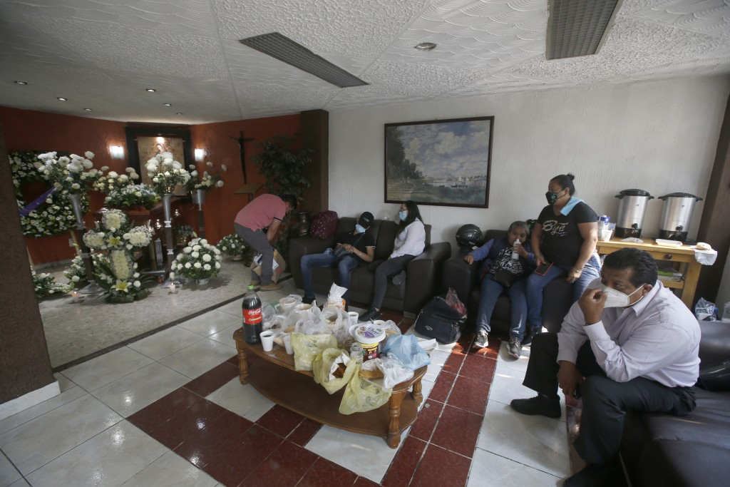 Friends and family attend a wake honoring Liliana Lopez, 37, who died in the Mexico City Metro collapse disaster, at a funeral home in Mexico City Wed...