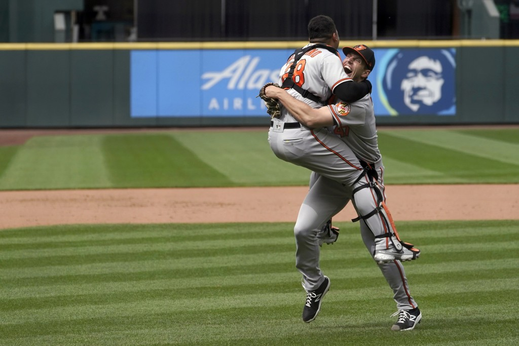 Baltimore Orioles starting pitcher John Means, right, celebrates with catcher Pedro Severino after Means threw a no-hitter baseball game against the S...