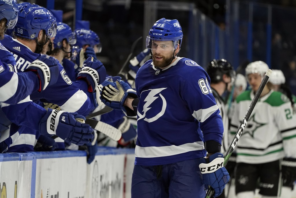 Tampa Bay Lightning defenseman Erik Cernak (81) celebrates his goal against the Dallas Stars with the bench during the third period of an NHL hockey g...