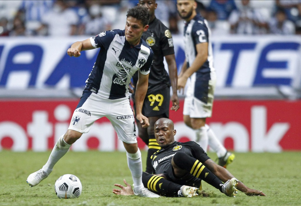 Jesus Gallardo of Mexico's Monterrey, left, and Bradley Wright Phillips of Unites States' Columbus Crew battle for the ball during a Concacaf Champion...