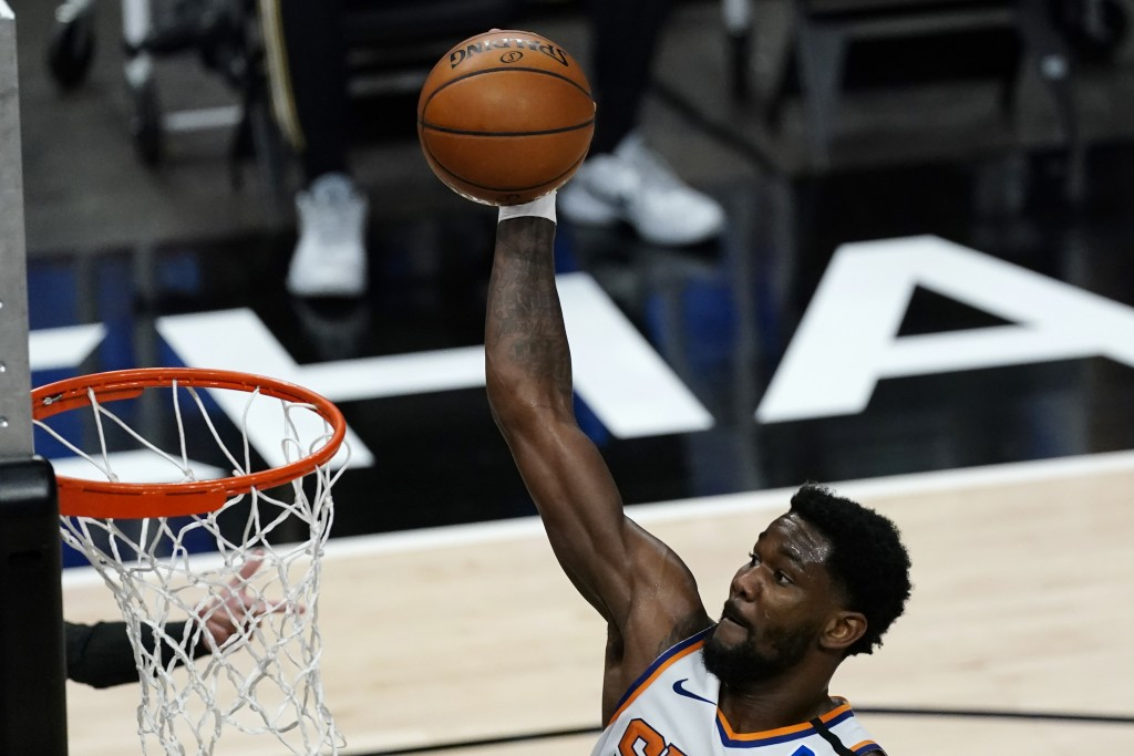 Phoenix Suns center Deandre Ayton (22) scores in the first half of an NBA basketball game against the Atlanta Hawks Wednesday, May 5, 2021, in Atlanta...