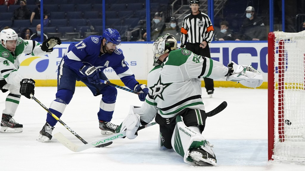 Tampa Bay Lightning left wing Alex Killorn (17) shoots past Dallas Stars goaltender Jake Oettinger (29) for a goal during the second period of an NHL ...