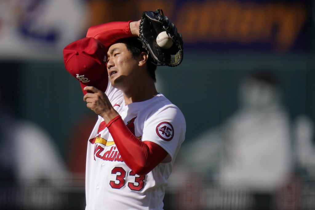 St. Louis Cardinals starting pitcher Kwang Hyun Kim pauses on the mound during the third inning in the first game of a baseball doubleheader against t...