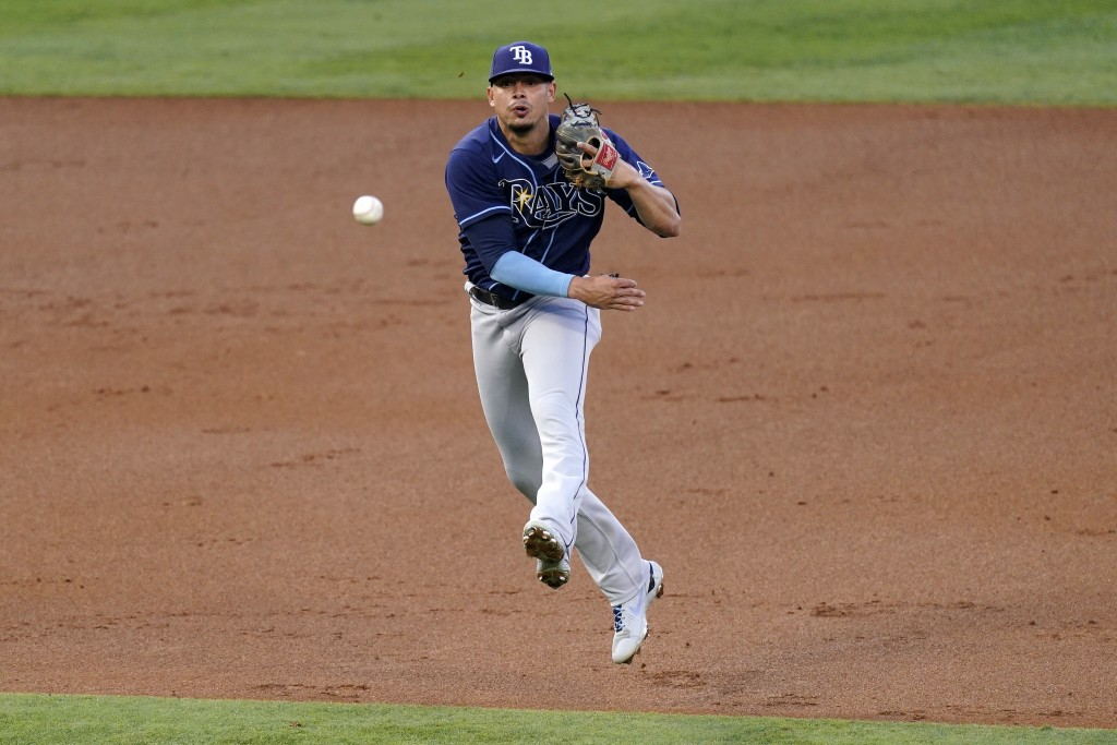 CORRECTS TO SECOND INNING, AND THAT IGLESIAS SINGLED - Tampa Bay Rays shortstop Willy Adames attempts to throw out Los Angeles Angels' Jose Iglesias a...