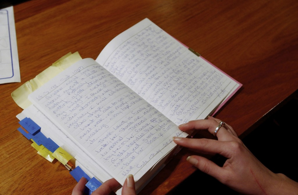 A diary belonging to Kathleen Folbigg is opened on a table in Sydney on May 22, 2003. Nearly two decades after Folbigg was convicted of killing her fo...
