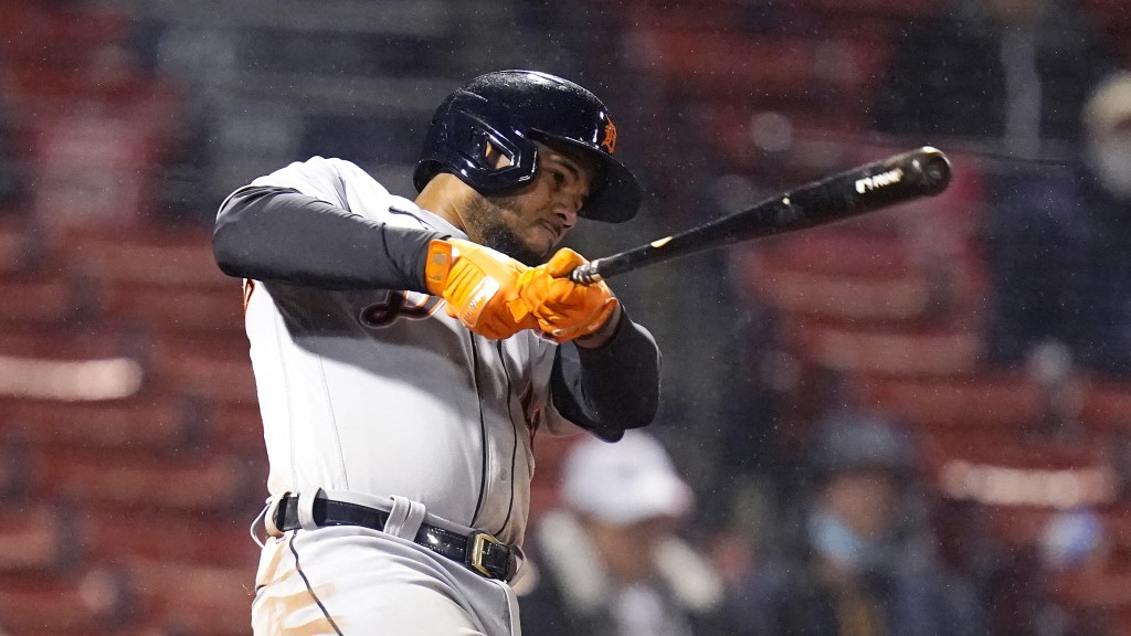 Detroit Tigers' Jeimer Candelario follows through on his three-run home run during the 10th inning of the team's baseball game against the Boston Red ...