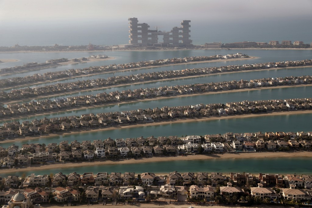 Villas one the fronds of the Jumeirah Palm Island are seen from the observation deck of The View at The Palm Jumeirah, in Dubai, United Arab Emirates,...