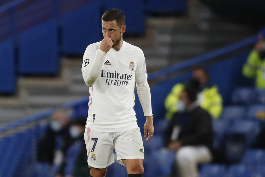 Real Madrid's Eden Hazard gestures after Chelsea's Mason Mount scored his side's second goal, during the Champions League semifinal 2nd leg soccer mat...