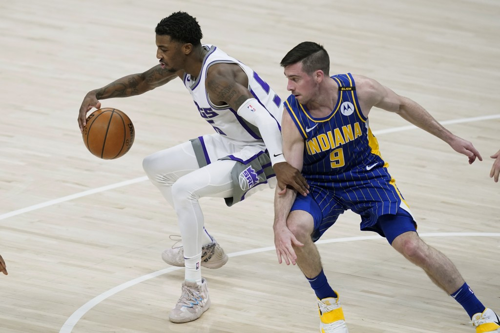 Sacramento Kings' Delon Wright (55) is defended by Indiana Pacers' T.J. McConnell (9) during the first half of an NBA basketball game Wednesday, May 5...