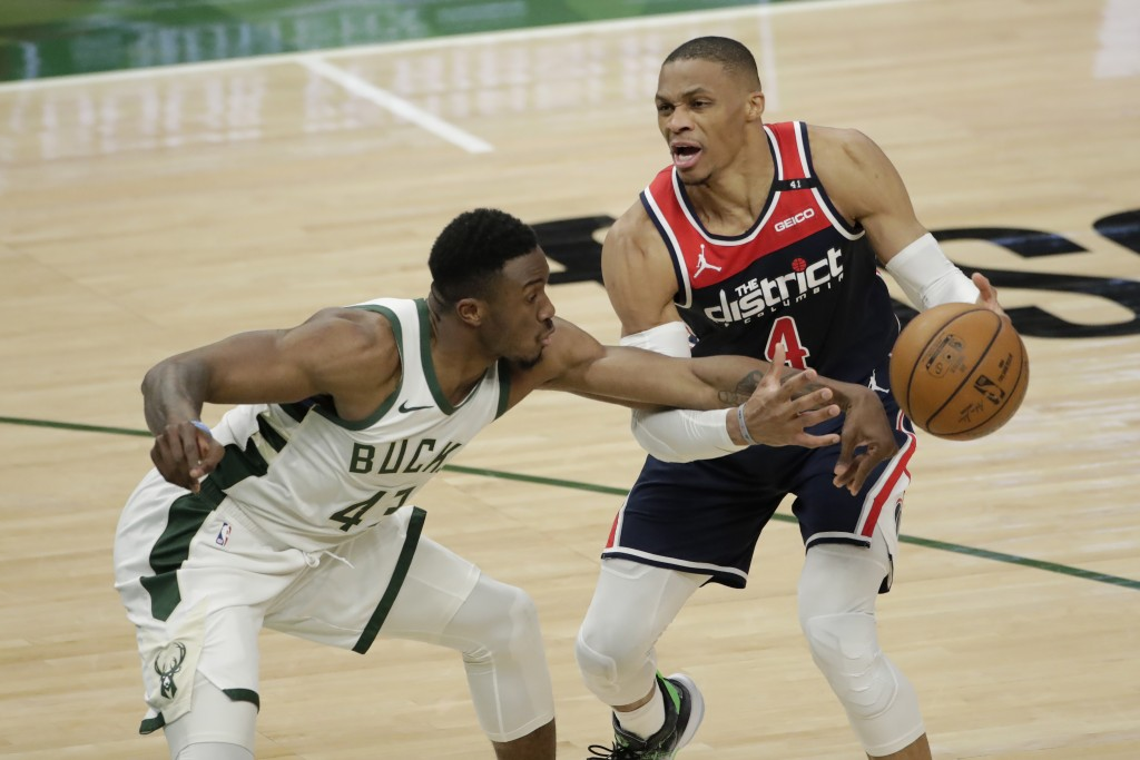 Washington Wizards' Russell Westbrook (4) is fouled by Milwaukee Bucks' Thanasis Antetokounmpo (43) during the first half of an NBA basketball game We...