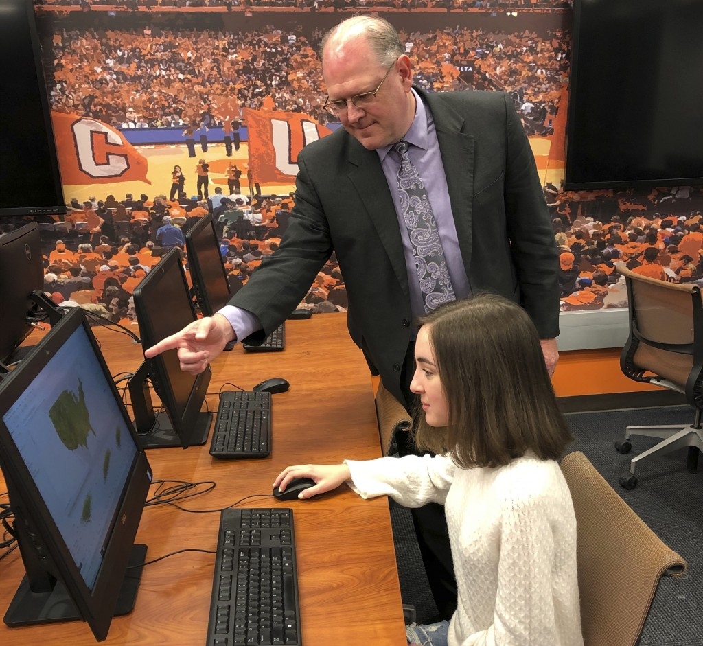 This undated photo provided by Syracuse University Falk College shows Rodney Paul, director of the sport analytics program, in the lab working with Ba...