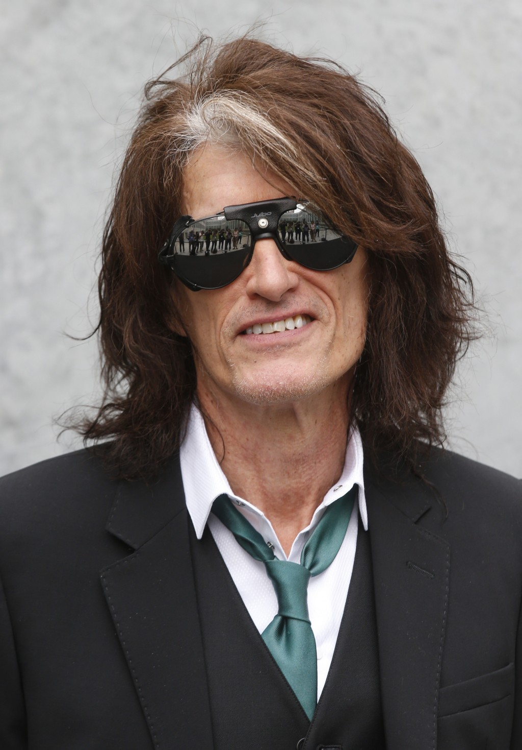 US guitarist Joe Perry attends the Emporio Armani men's Spring-Summer 2015 show, part of the Milan Fashion Week, unveiled in Milan, Italy, Monday, Jun...