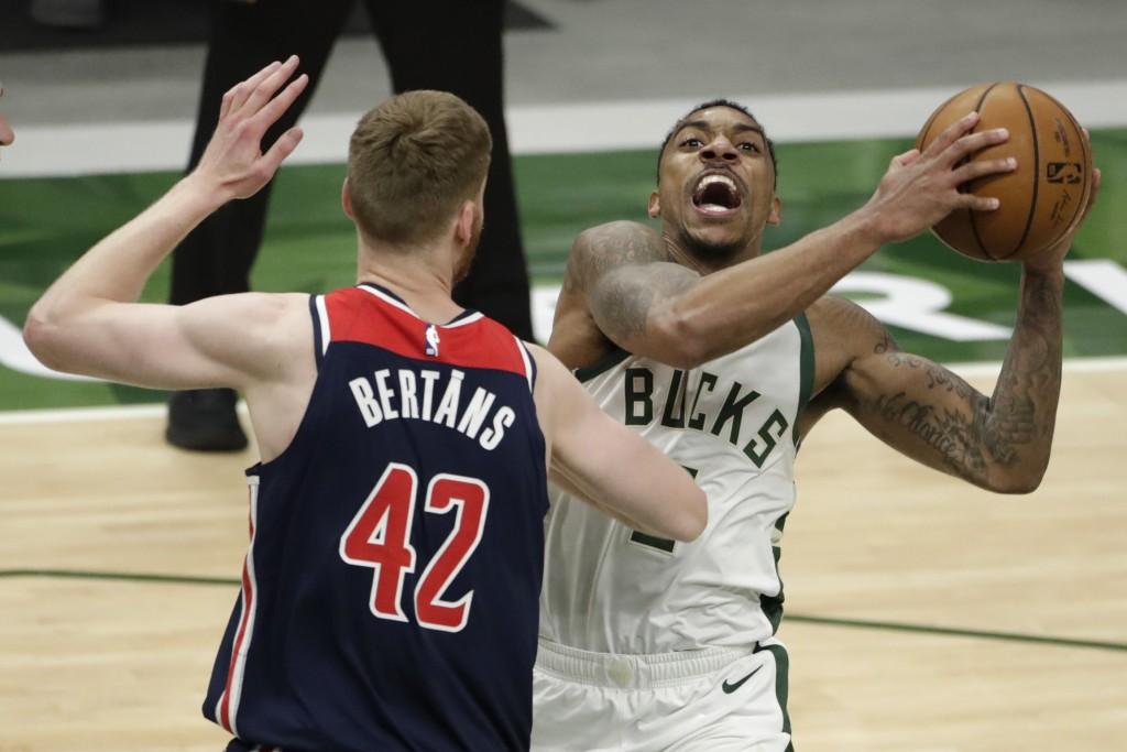 Milwaukee Bucks' Jeff Teague drives to the basket against Washington Wizards' Davis Bertans (42) during the second half of an NBA basketball game Wedn...