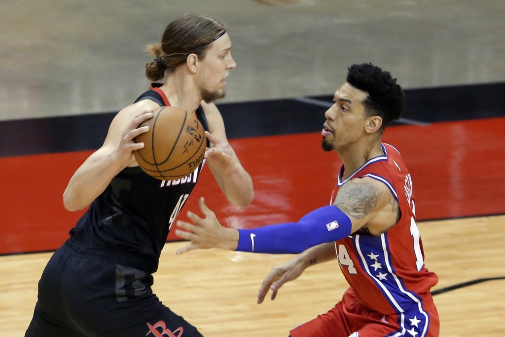 Houston Rockets forward Kelly Olynyk, left, looks to drive around Philadelphia 76ers forward Danny Green, right, during the first half of an NBA baske...