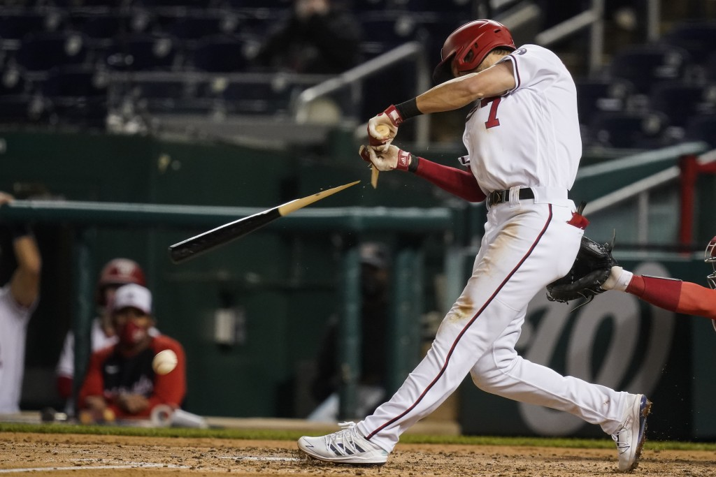 Washington Nationals shortstop Trea Turner breaks his bat as he hits into a double play during the fifth inning of the team's baseball game against th...