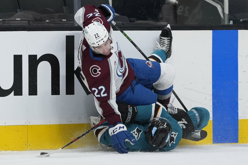 Colorado Avalanche defenseman Conor Timmins (22) collides with San Jose Sharks center Dylan Gambrell (7) during the second period of an NHL hockey gam...