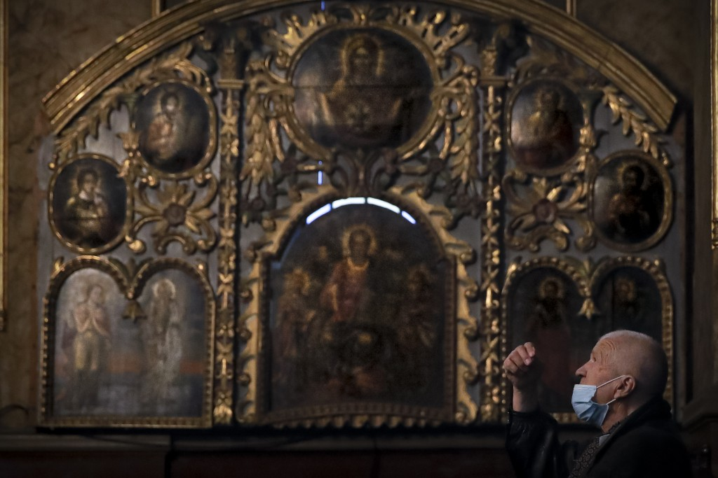 A man from the Armenian community in Romania prays during a Maundy Thursday religious service, at the Armenian Church in Bucharest, Romania, Thursday,...