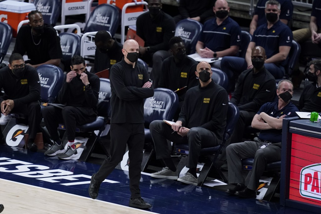 Indiana Pacers coach Nate Bjorkgren watches during the second half of the team's NBA basketball game against the Sacramento Kings, Wednesday, May 5, 2...