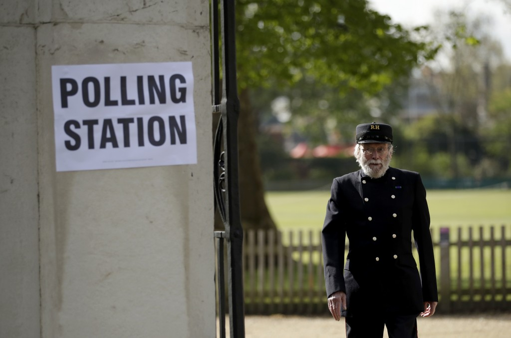 A Chelsea Pensioner walks past a sign for a polling station after voting in London, Thursday, May 6, 2021. Millions of people across Britain will cast...