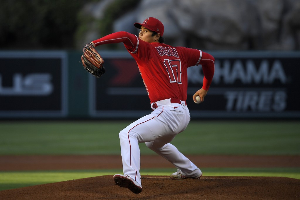 CORRECTS POSITION TO STARTING PITCHER INSTEAD OF DESIGNATED HITTER - Los Angeles Angels starting pitcher Shohei Ohtani throws to the plate during the ...