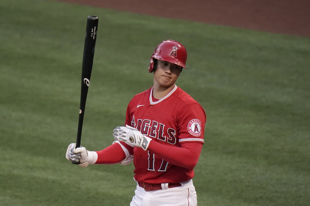 Los Angeles Angels' Shohei Ohtani reacts after striking out during the first inning of the team's baseball game against the Tampa Bay Rays, Thursday, ...