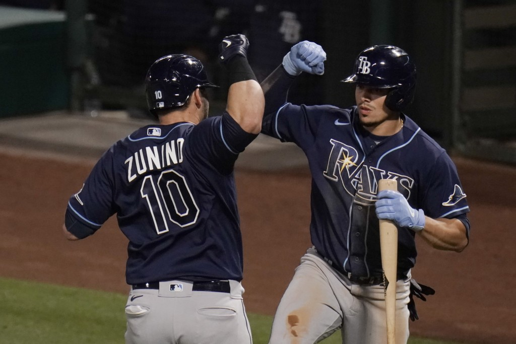 Tampa Bay Rays' Mike Zunino, left, celebrates his home run with Willy Adames during the seventh inning of the team's baseball game against the Los Ang...