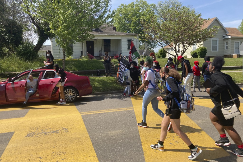In this April 27, 2021 photo, students walk out of school at Austin-East Magnet High School in Knoxville, Tenn. Members of the Black community in Knox...