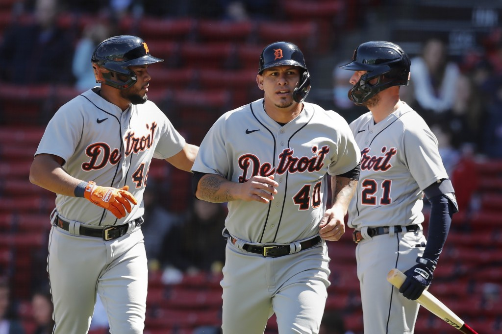 Detroit Tigers' Wilson Ramos (40) and Jeimer Candelario (46) celebrate with JaCoby Jones (21) after scoring on a double by Harold Castro during the fo...