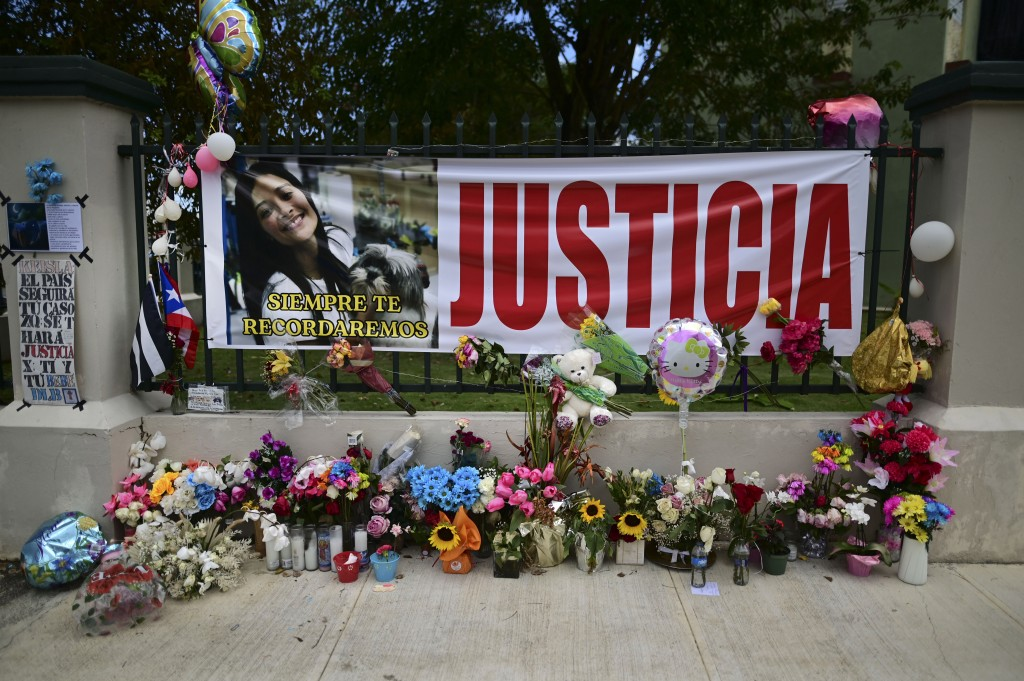 """Flowers, balloons and a poster with the Spanish word for """"justice"""" is part of a growing makeshift memorial for Keishla Rodriguez whose lifeless body w..."""