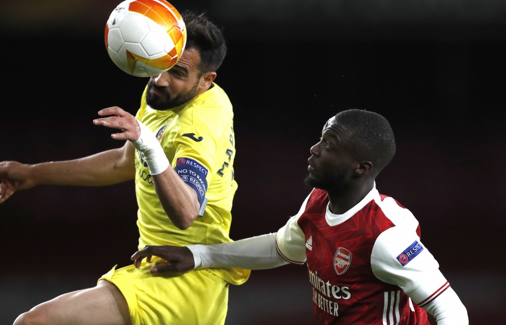 Villareal's Mario Gaspar, left, and Arsenal's Nicolas Pepe challenge for the ball during the Europa League semifinal second leg soccer match between A...