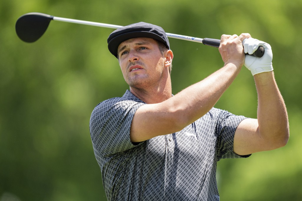 Bryson DeChambeau watches his tee shot on the third hole during the first round of the Wells Fargo Championship golf tournament at Quail Hollow Club o...
