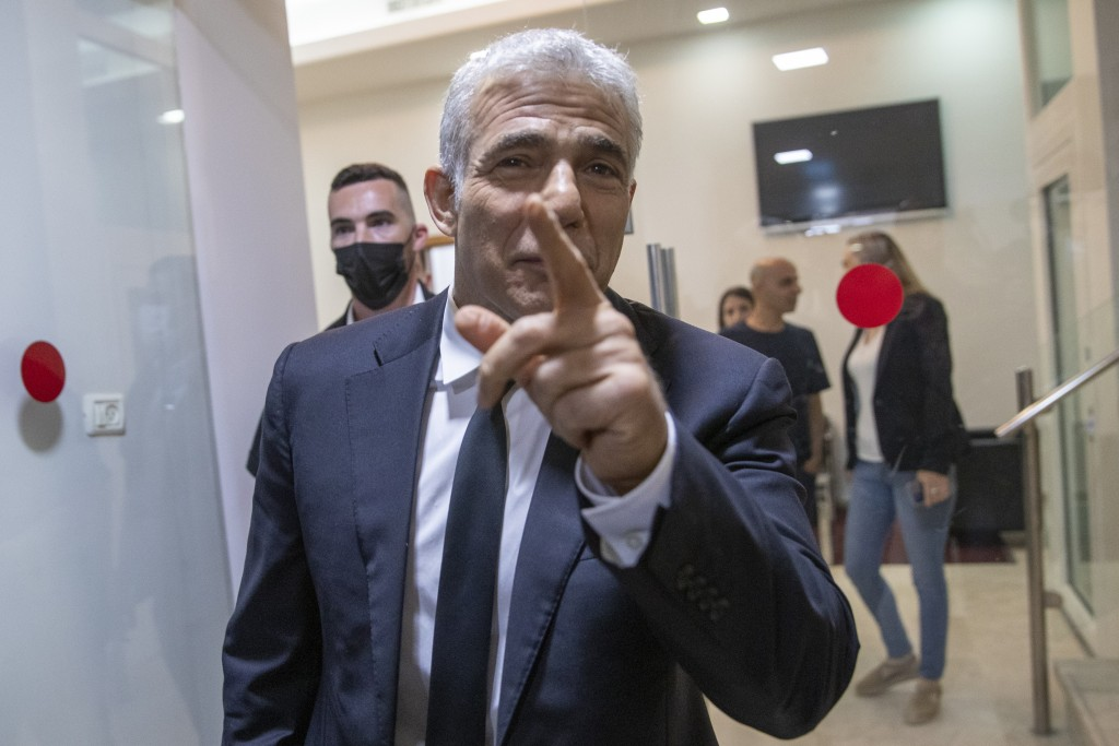 REPLACES COMMON GOOD INSTEAD OF COMMON GROUND - Israeli opposition leader Yair Lapid, arrives for a news conference in Tel Aviv, Thursday, May. 6, 202...