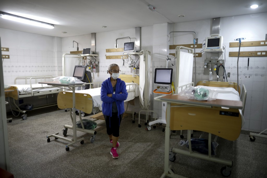 Chief of Surgical Services Alicia Rey stands inside the ICU of the San Andres Clinic which has been occupied by its former workers since it closed at ...