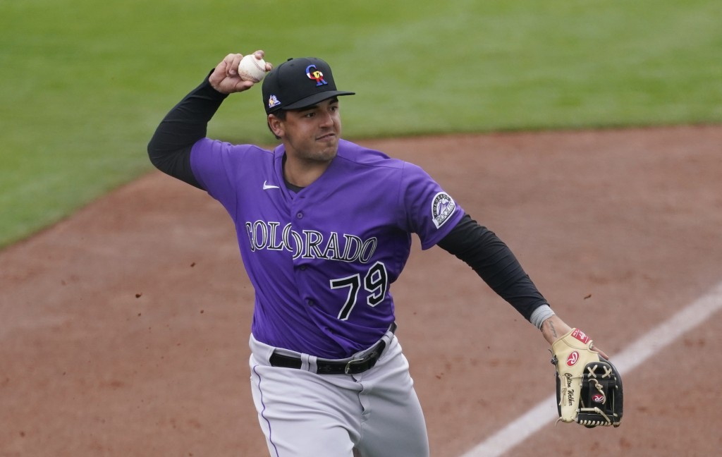 FILE - In this March 12, 2021, file photo, Colorado Rockies third baseman Colton Welker throws to first during the team's spring training baseball gam...