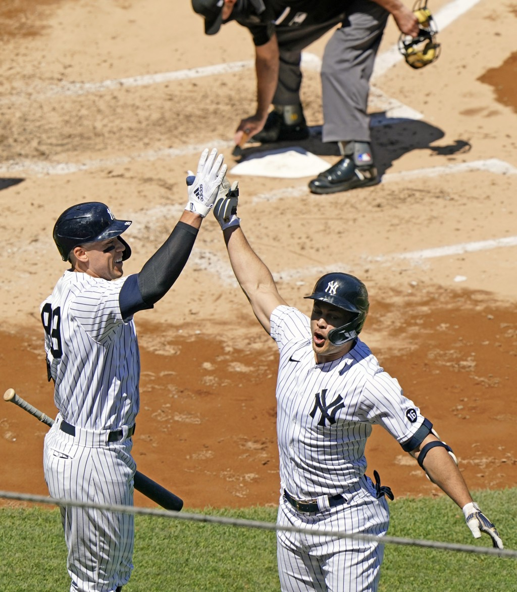 On-deck batter New York Yankees Aaron Judge, left, celebrates with Yankees designated hitter Giancarlo Stanton after Stanton hit a solo home run durin...