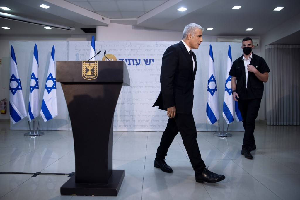 REPLACES COMMON GOOD INSTEAD OF COMMON GROUND -  Israeli opposition leader Yair Lapid, leaves the podium at the end of a news conference in Tel Aviv, ...