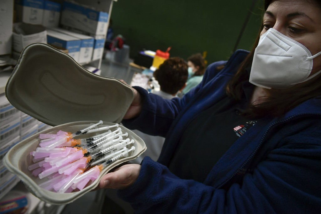 A health worker prepares Pfizer vaccines before people receive a shot during a COVID-19 vaccination campaign, in Pamplona, northern Spain, Friday, May...