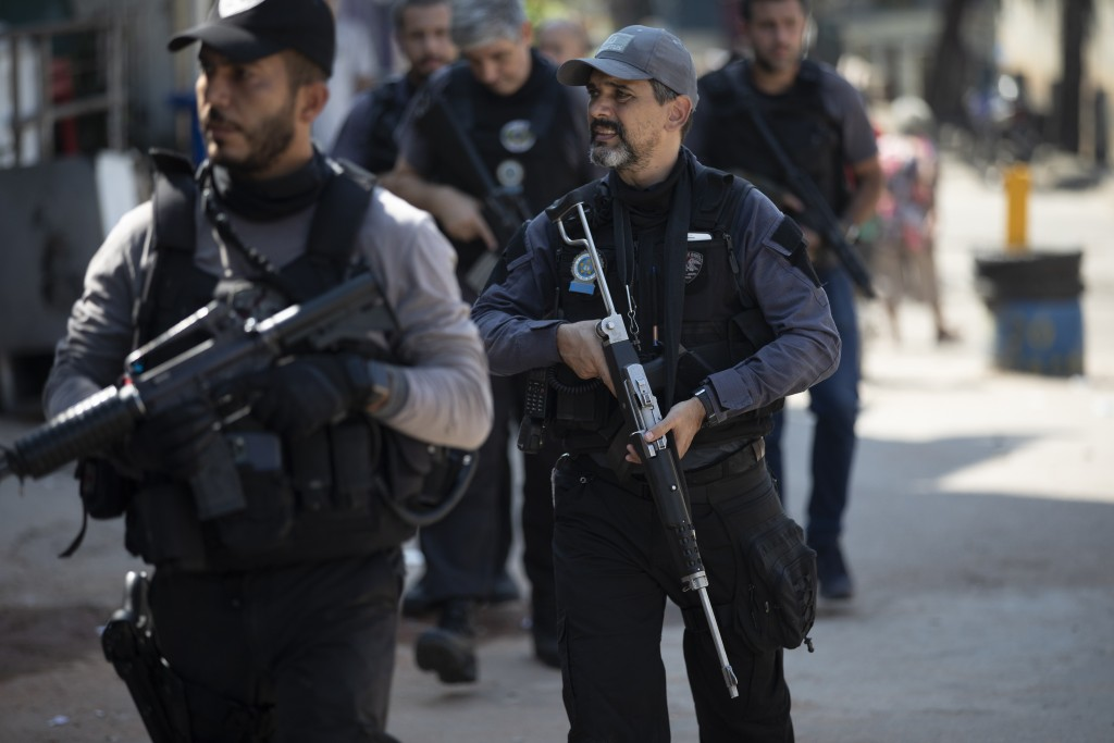 Police conduct an operation against alleged drug traffickers in the Jacarezinho favela of Rio de Janeiro, Brazil, Thursday, May 6, 2021. (AP Photo/Sil...