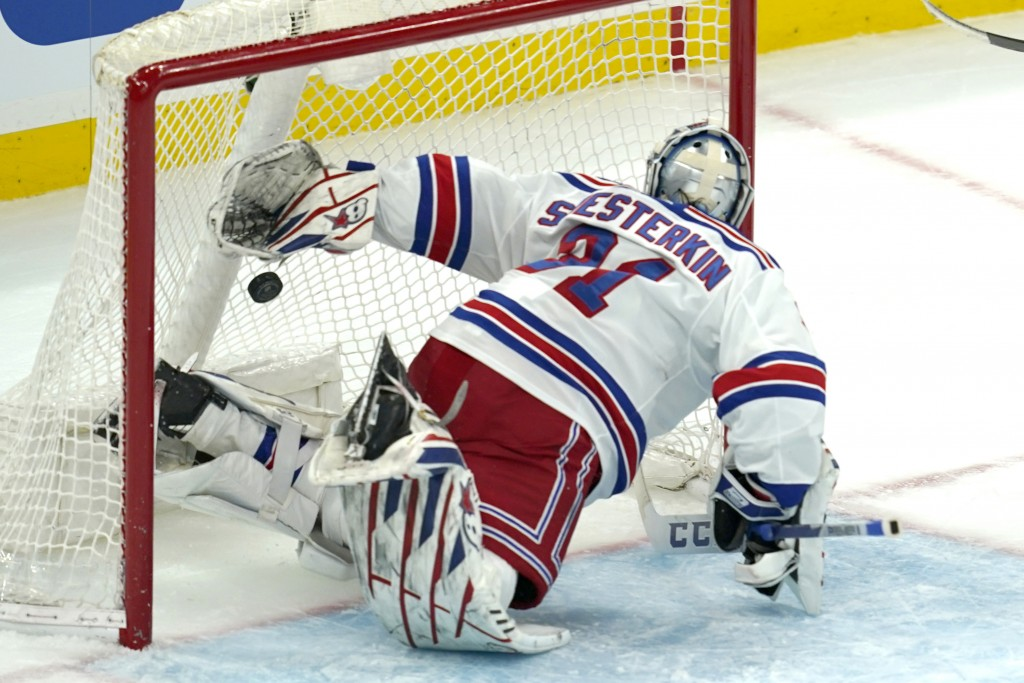 New York Rangers goaltender Igor Shesterkin watches the puck go past him for a goal by Boston Bruins left wing Jake DeBrusk (74) in the second period ...