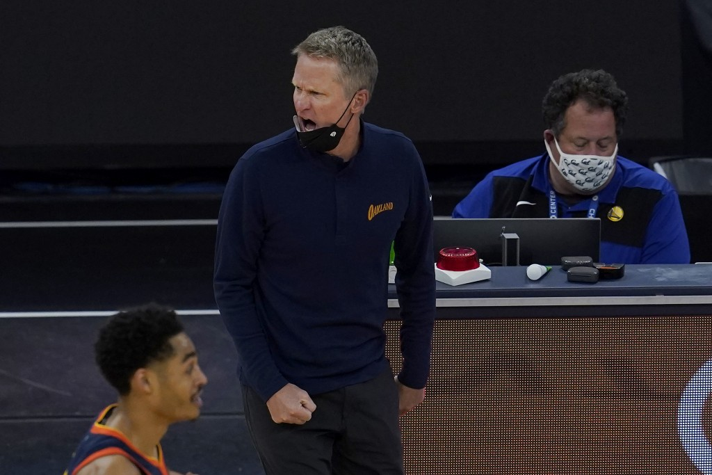 Golden State Warriors head coach Steve Kerr reacts to an official's call during the first half of his team's NBA basketball game against the Oklahoma ...