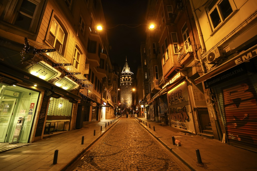 FILE - This April 29, 2021, file photo, shows the deserted street leading to the iconic Galata Tower in Istanbul after the start of the latest lockdow...