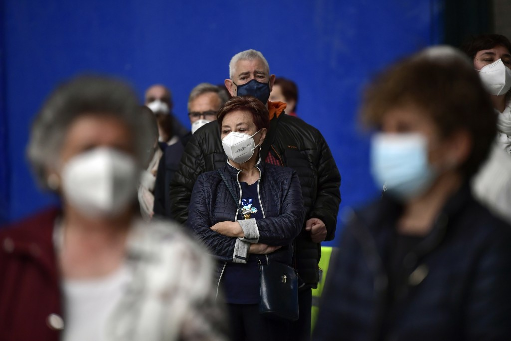 People wearing face mask protection to prevent the spread of the coronavirus while waiting to receive a shot of Pfizer vaccine during a COVID-19 vacci...