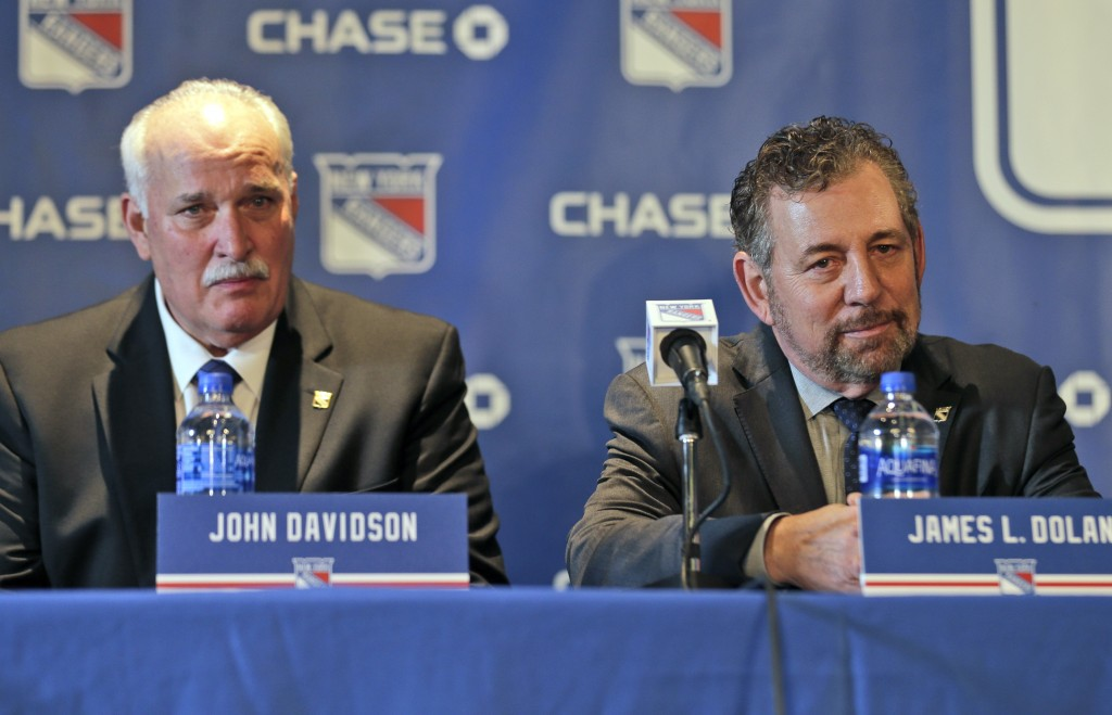 FILE - John Davidson, left, and James Dolan, owner of the New York Rangers, participate in a news conference in New York, in this Wednesday, May 22, 2...