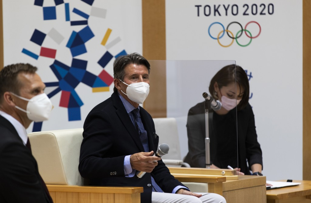 Sebastian Coe, center, the president of World Athletics, an internationally governing organization for the sport of athletics, watches the media leave...