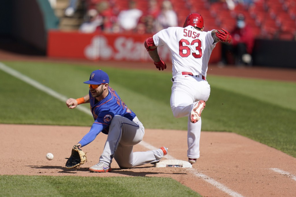 St. Louis Cardinals' Edmundo Sosa (63) grounds out as New York Mets first baseman Pete Alonso handles the throw during the ninth inning of a baseball ...