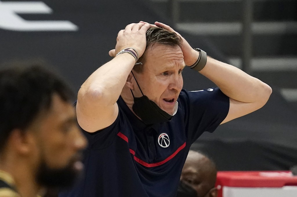 Washington Wizards head coach Scott Brooks reacts to an official's call during the second half of an NBA basketball game against the Toronto Raptors T...