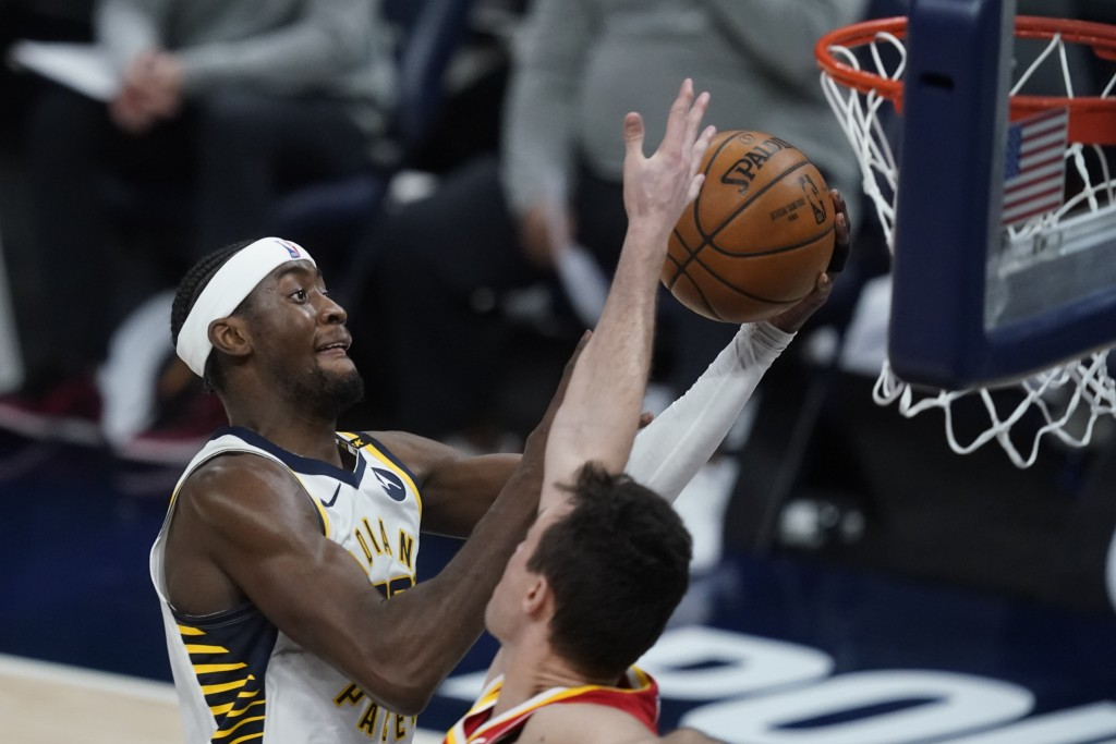 Indiana Pacers' Caris LeVert shoots against Atlanta Hawks' Danilo Gallinari during the second half of an NBA basketball game Thursday, May 6, 2021, in...