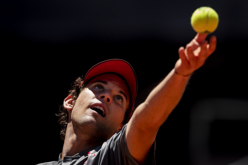 Austria's Dominic Thiem serves to United States' John Isner during their match at the Mutua Madrid Open tennis tournament in Madrid, Spain, Friday, Ma...