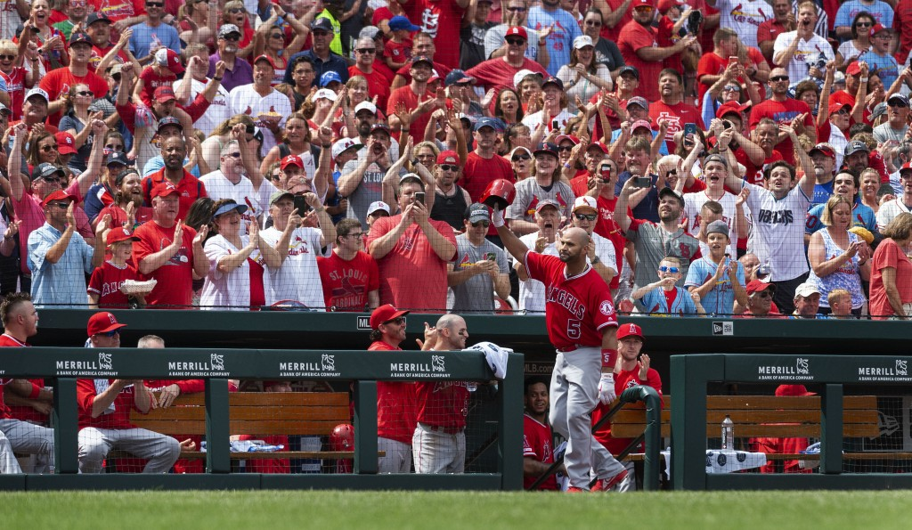 FILE - Los Angeles Angels' Albert Pujols waves to fans after getting a curtain call when he hit a home run during seventh inning of a baseball game ag...