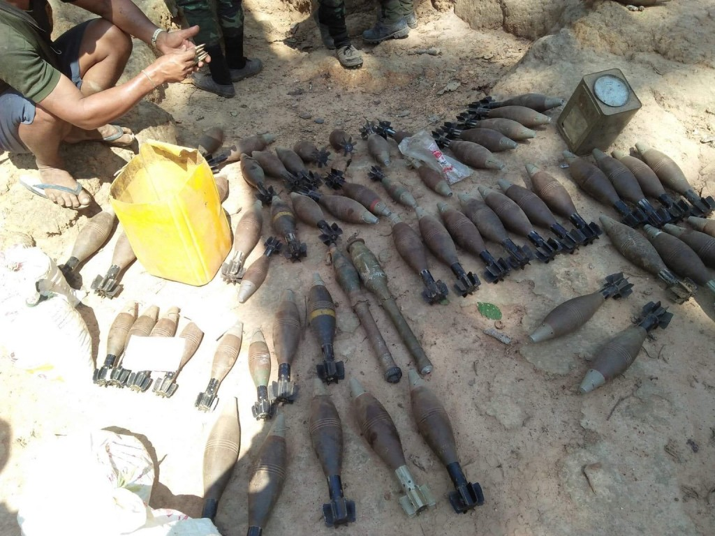 In this photo provided by Karen National Liberation Army, a cache of mortar shells are gathered together on the ground of a Myanmar military outpost F...